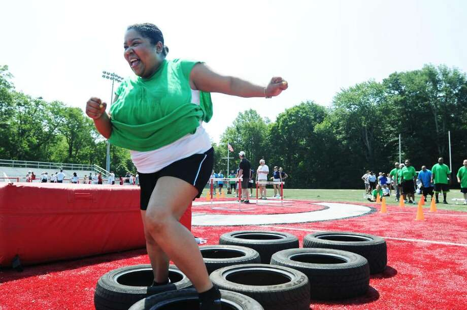 Kaliska Bradshaw runs through the obstacle course as she competes with team DeFoe in The Pro Sports Challenge at New Canaan High School in New Canaan, Conn. on Saturday June 26, 2010. Photo: Kathleen O'Rourke / Stamford Advocate