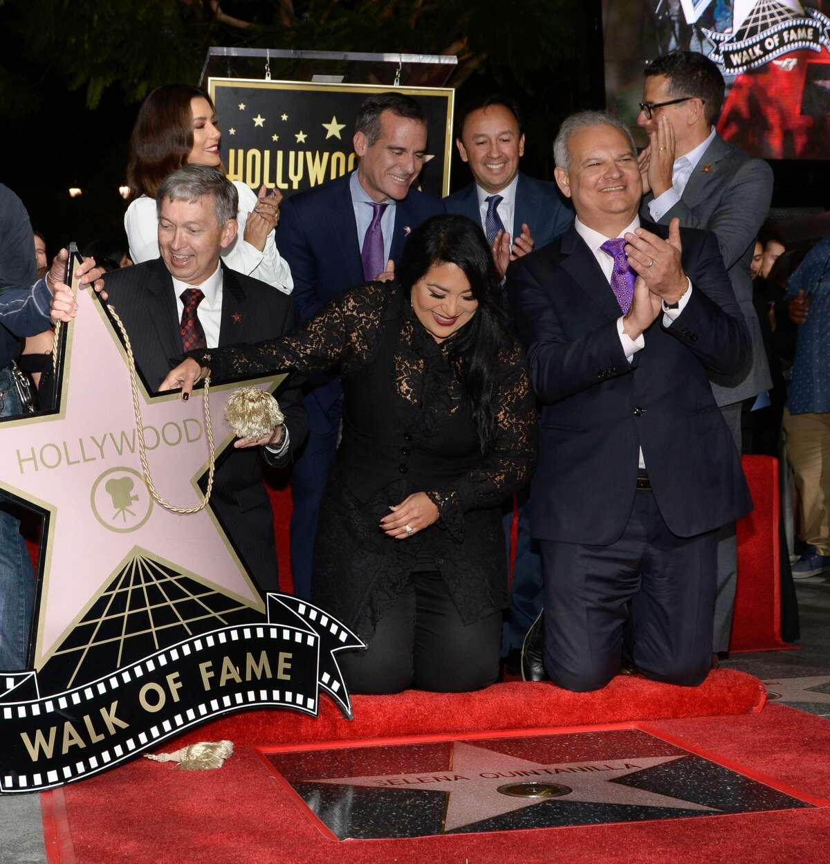 Eva Longoria (back L), Mayor of Los Angeles Eric Garcetti (back C), Victor Gonzalez, Suzette Quintanilla (front C), Leron Gubler (front L) attend the ceremony honoring singer Selena Quintanilla with a Star on the Hollywood Walk of Fame on November 3, 2017, in Hollywood, California. / AFP PHOTO / TARA ZIEMBA (Photo credit should read TARA ZIEMBA/AFP/Getty Images)