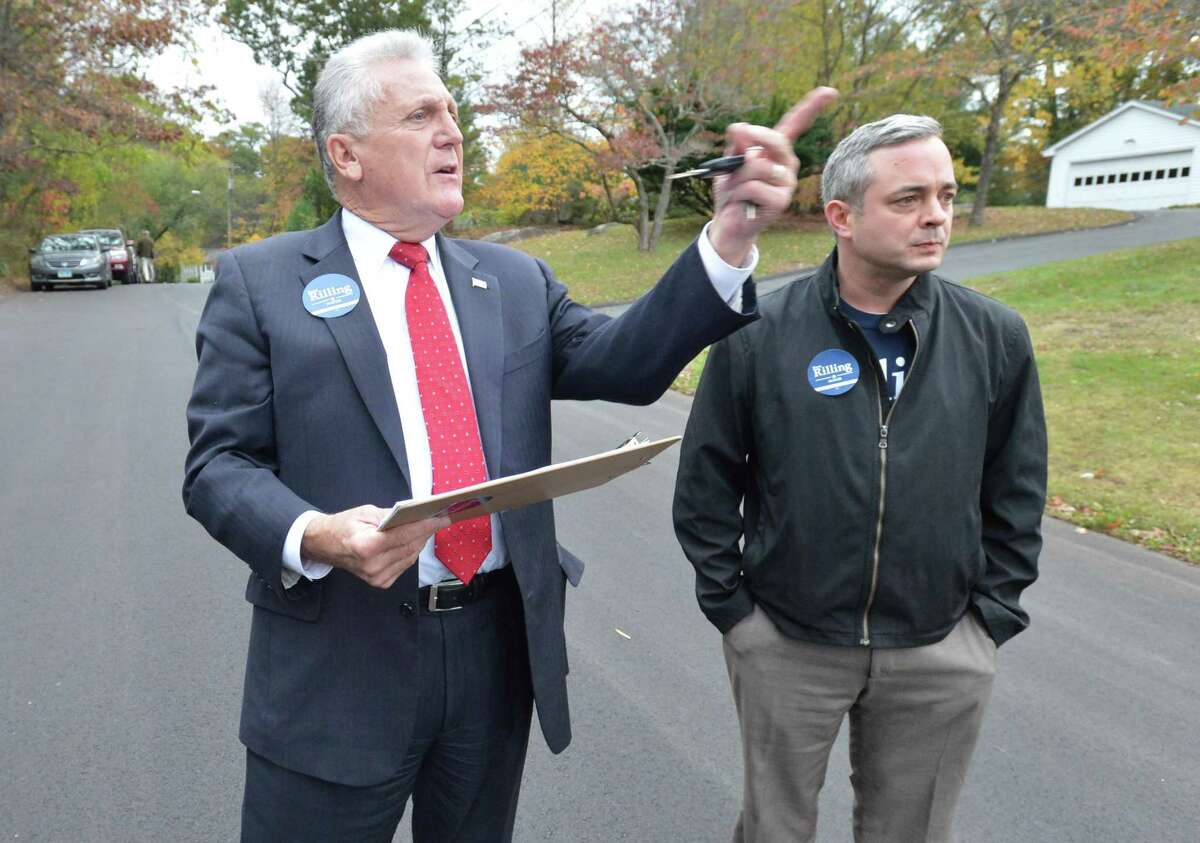Mayor Harry Rilling and campaign manager Jesse Hubbard look for an address while knocking on doors in West Norwalk meeting residents and handing out information on Wednesday November 1, 2017 in Norwalk Conn.
