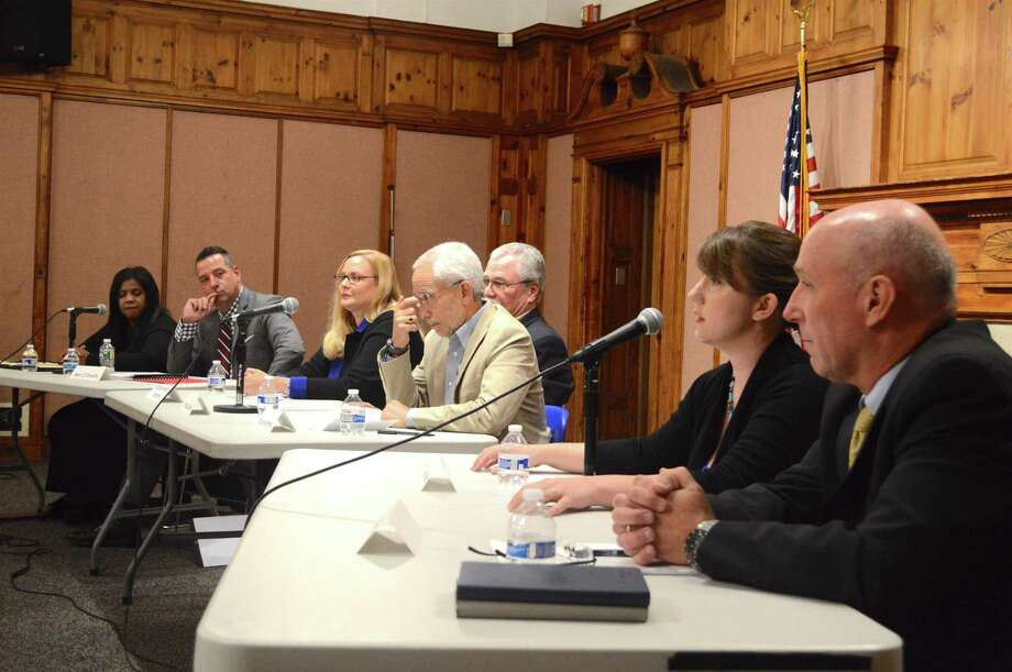 Board of Education candidates during a recent debate at Norwalk City Hall are, from left, Shirley Mosby, Marc D'Amelio, Barbara Meyer Mitchell, Bruce Kimmel, Thomas Cullen, Sarah Lemieux and Thomas Donaher. Photo: Jarret Liotta / For Hearst Connecticut Media