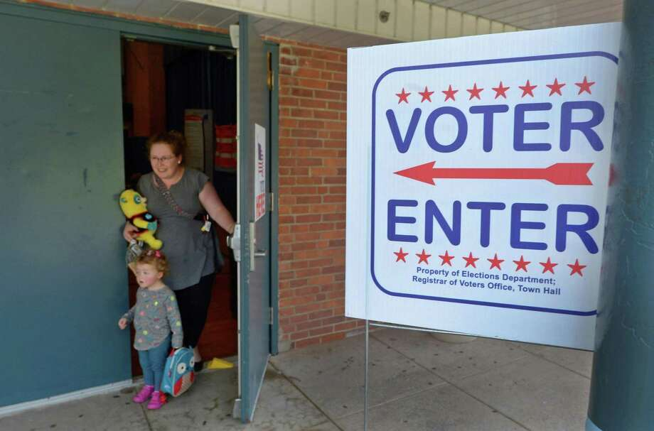 Pauline Alperin and her daughter Evelyn , 2, leave at Kendall Elementary School as District A Democrats head to the polls Tuesday, Sept. 12, as part of a primary election for two seats on the Norwalk Common Council this November. Photo: Erik Trautmann / Hearst Connecticut Media / Norwalk Hour