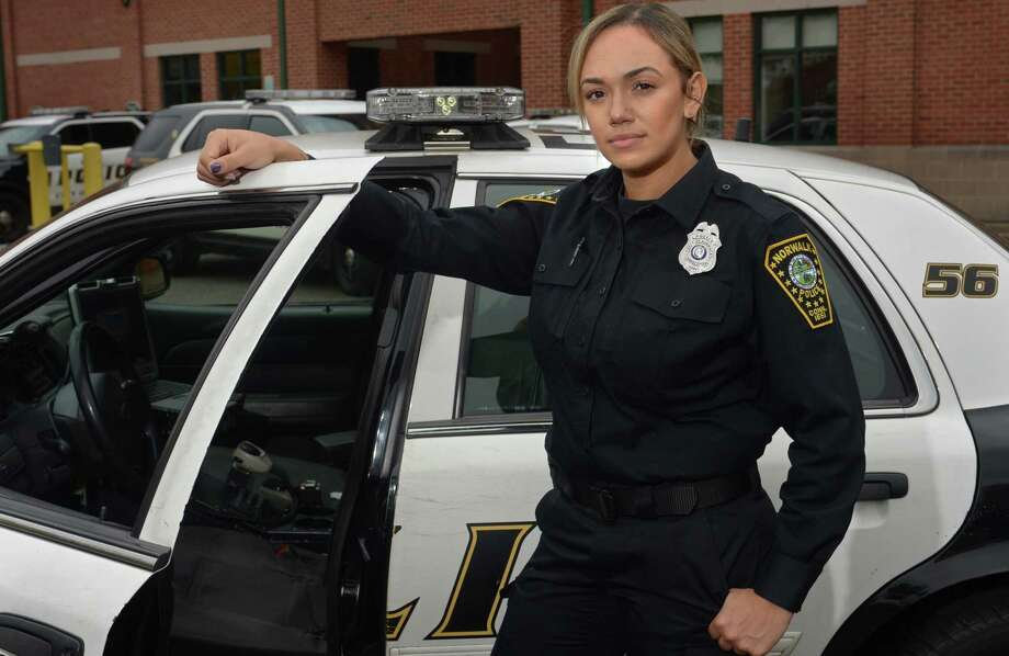 Officer Tiffany Ortiz at the Norwalk Police Department Thursday, Nov. 2, in Norwalk after joining the force from the New Haven Police Department. Ortiz is the first female Hispanic officer to join Norwalk Police Department in 30 years. Photo: Erik Trautmann / Hearst Connecticut Media / Norwalk Hour