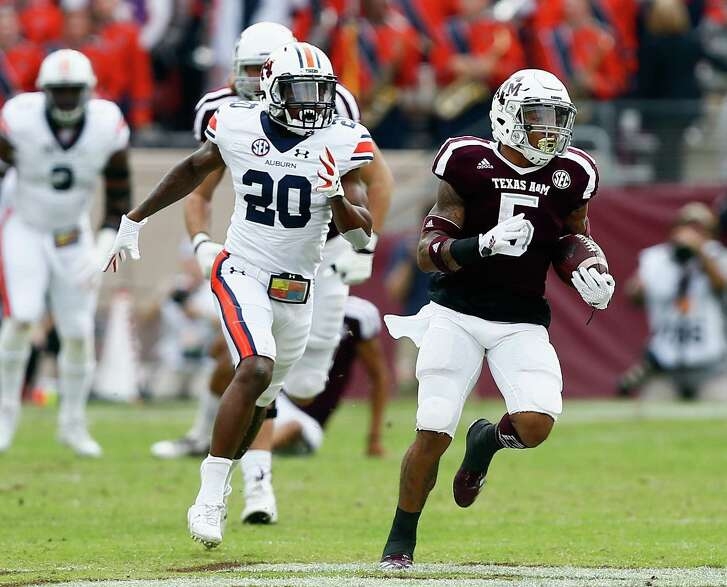 COLLEGE STATION, TX - NOVEMBER 04:  Trayveon Williams #5 of the Texas A&M Aggies rushes past Jeremiah Dinson #20 of the Auburn Tigers in the first quarter at Kyle Field on November 4, 2017 in College Station, Texas.
