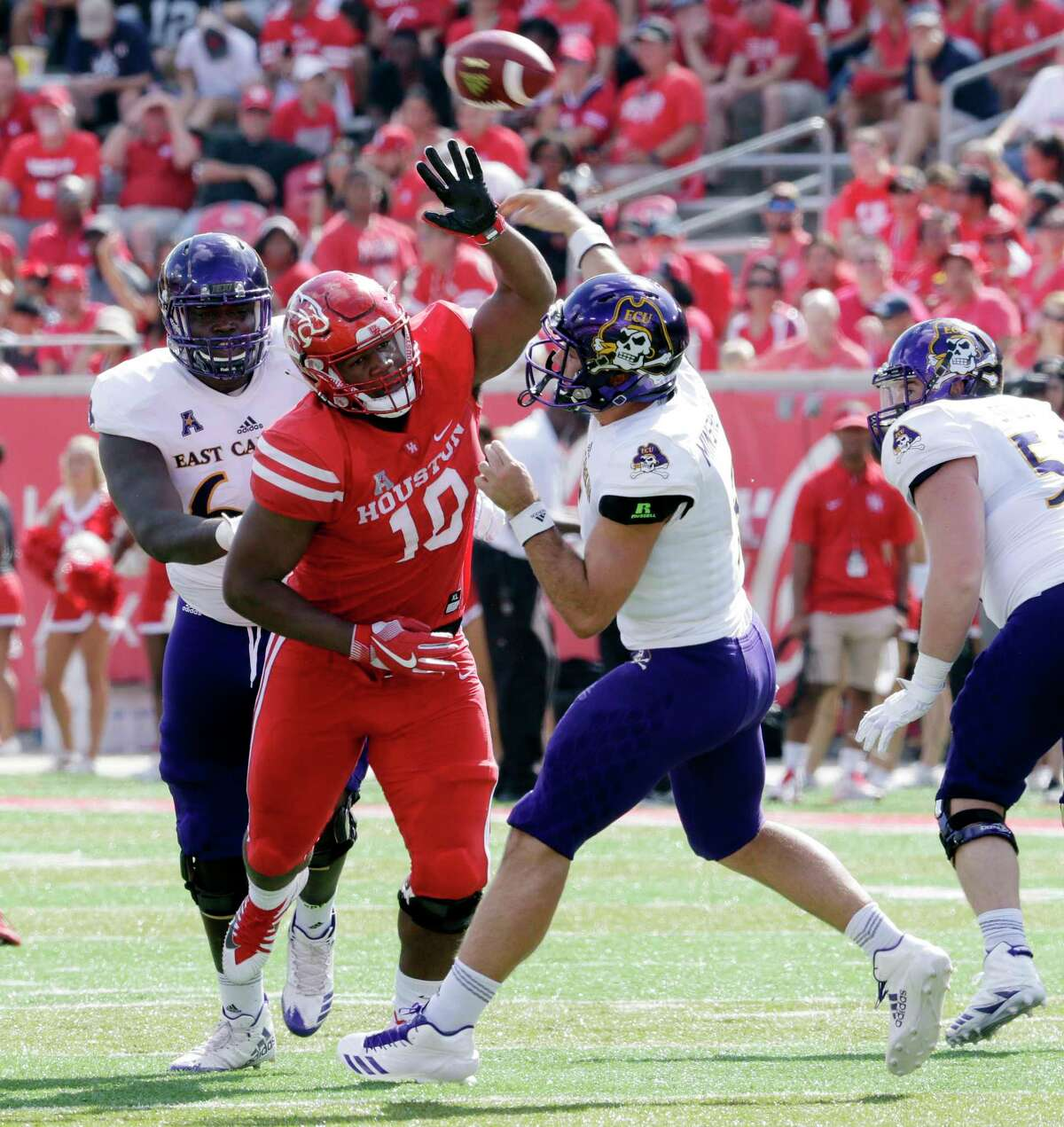 Houston defensive tackle Ed Oliver (10) tries to break up the pass by East Carolina quarterback Gardner Minshew (5) in the first half of their game, Nov. 4, 2017, in Houston, TX. (Michael Wyke / For the Chronicle)