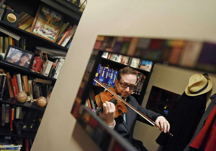 Greenwich Symphony Orchestra Principal Violist David Creswell poses with his viola in his apartment in New York. Creswell has been Principal Violist in the Greenwich Symphony Orchestra since 2003 and also performs in several Broadway musicals, substitutes with the New York Philharmonic, records studio work and teaches at the Julliard School. Photo: Tyler Sizemore / Hearst Connecticut Media / Greenwich Time