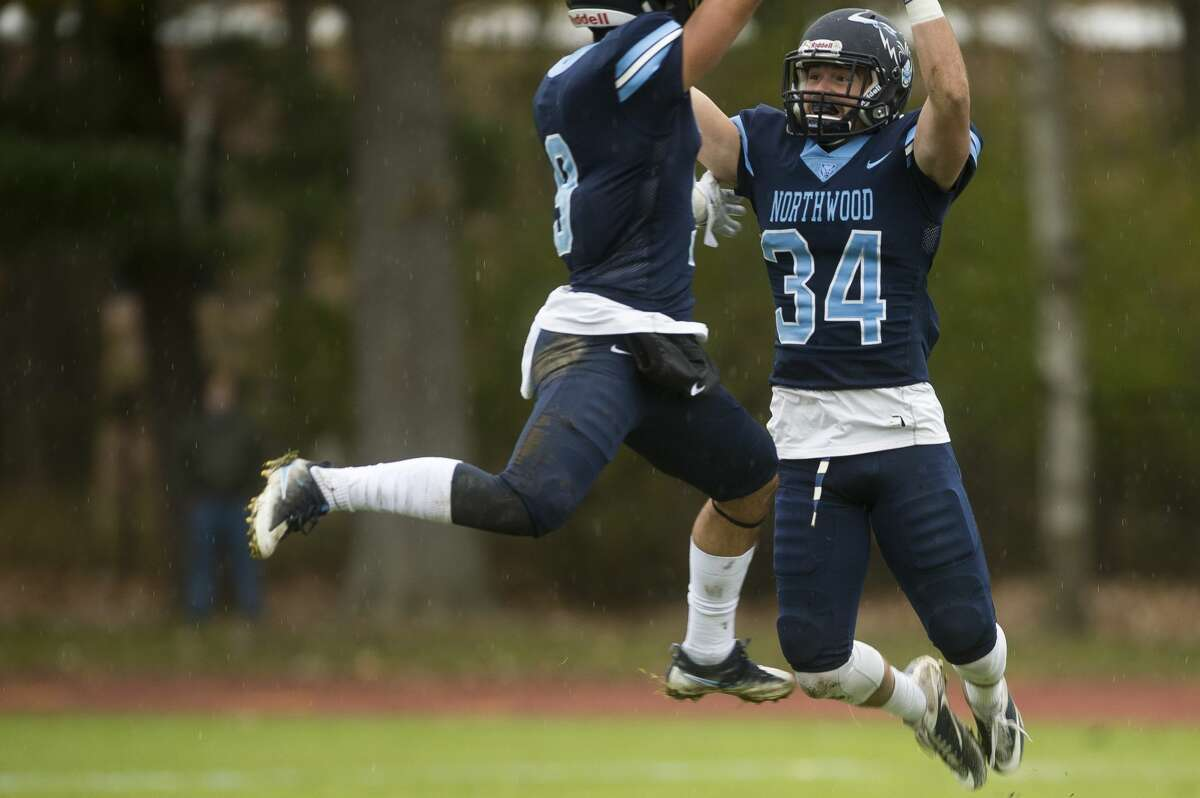 Northwood defensive back Chad Samuels (34) jumps up to celebrate a play with defensive back Dimitri Abro during Northwood's game against SVSU on Saturday, Nov. 4, 2017 at Northwood University. (Katy Kildee/kkildee@mdn.net)