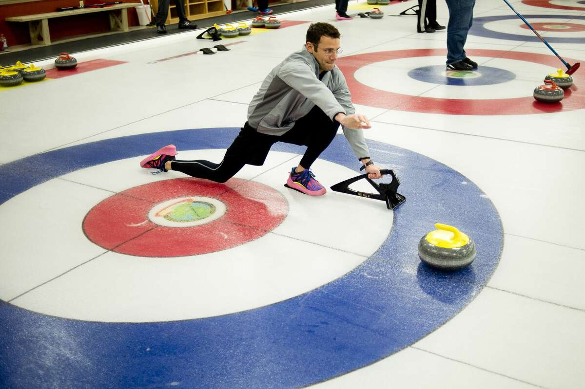 David Snider of Midland learns how to throw a stone during a curling open house on Saturday, Nov. 4, 2017 at the Greater Midland Curling Club. (Katy Kildee/kkildee@mdn.net)
