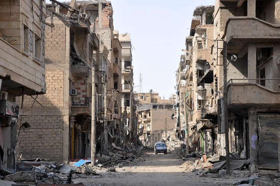 Damaged buildings in the eastern Syrian city of Deir el-Zour show the intensity of recent fighting to oust Islamic State militants from their former stronghold. Photo: STRINGER, AFP/Getty Images