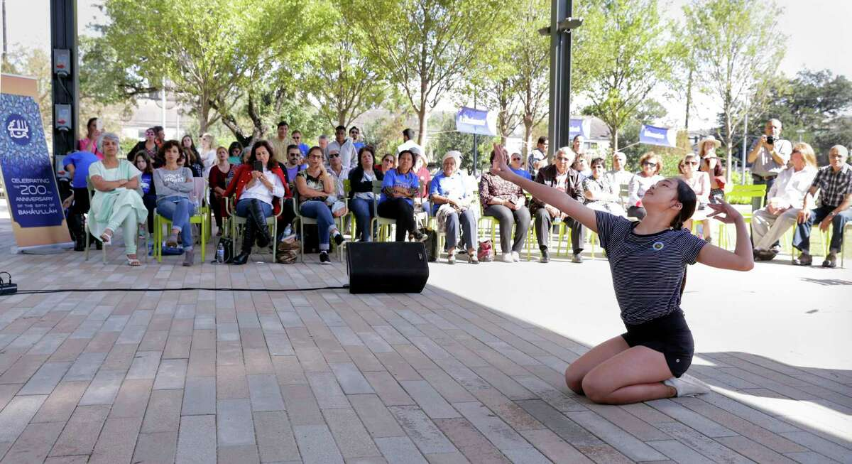 """Amy Sun performs an original dance titled """"Is There Any Remover of Difficulty"""" during the Baha'i celebration marking the bicentennial of the birth of the prophet Baha' u' llah Oct. 22, 2017 at Levy Park in Houston, TX. (Michael Wyke / For the Chronicle)"""