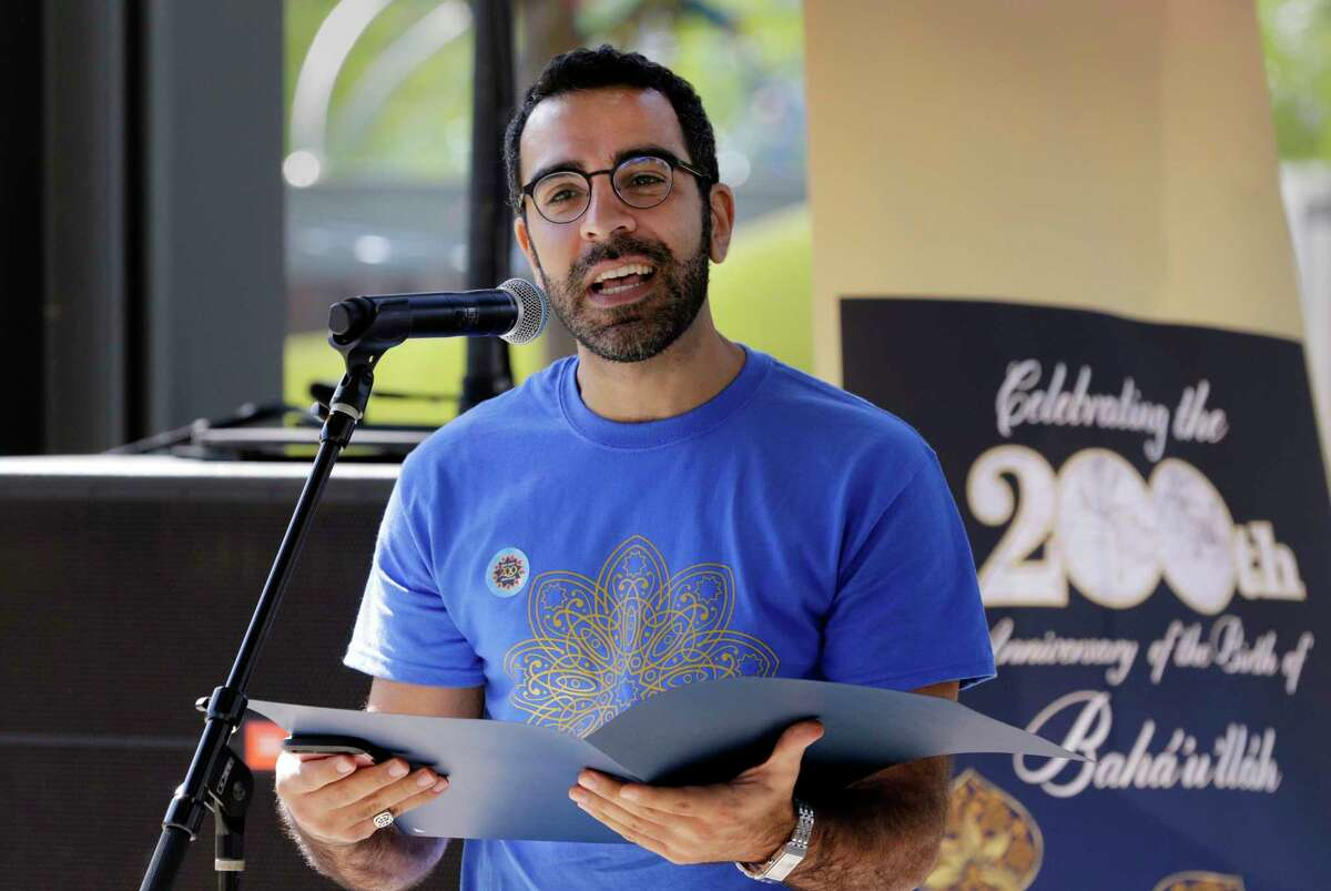 Abbas Mahvash reads a proclamation from mayor Sylvester Turner during the Baha'i celebration marking the bicentennial of the birth of the prophet Baha' u' llah Oct. 22, 2017 at Levy Park in Houston, TX. (Michael Wyke / For the Chronicle)