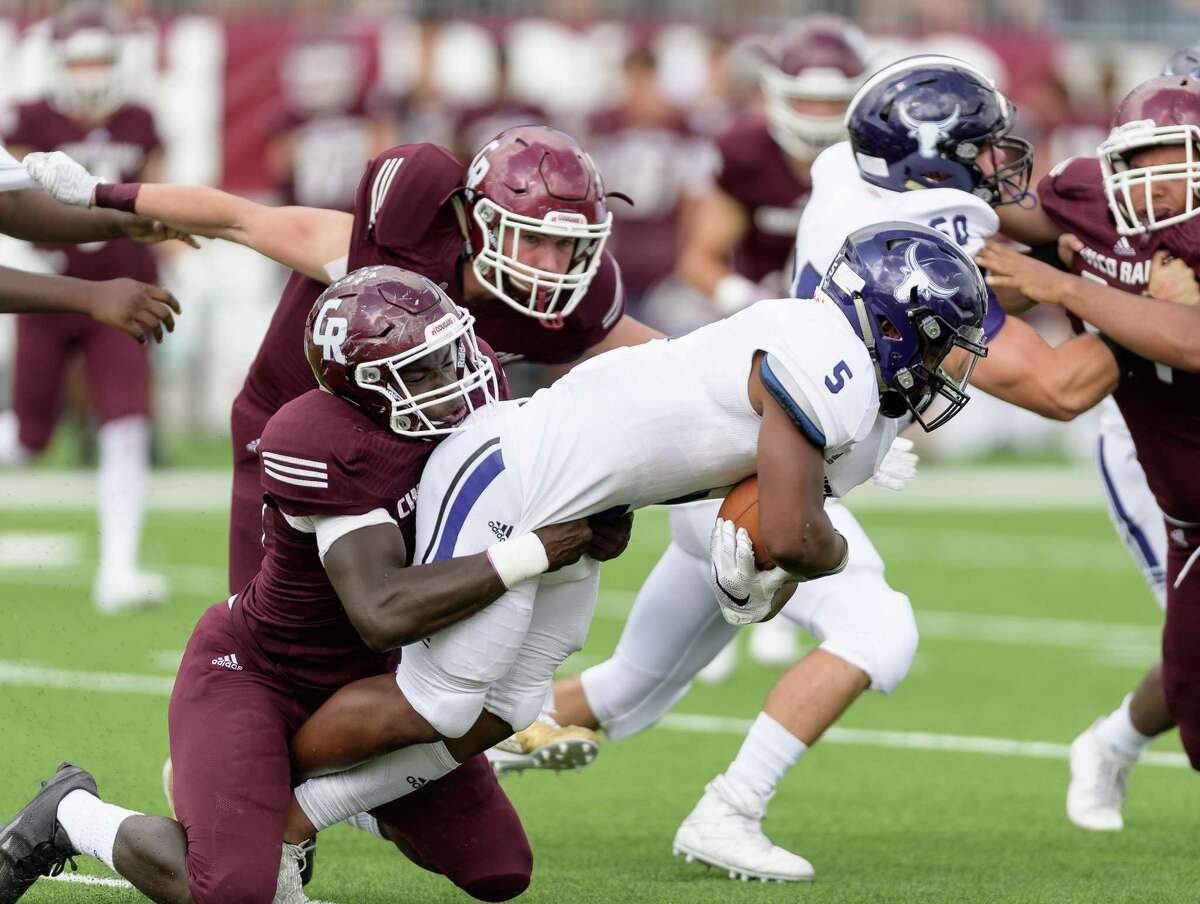Josh Bennett (5) of the Morton Ranch Mavericks is brought down by David Gbenda (33) of the Cinco Ranch Cougars in the first half of a high school football game on Saturday, November 4, 2017 at Legacy Stadium in Katy Texas.
