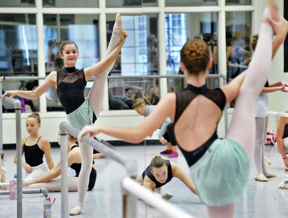 Allison Bonds, 12, of Ballston Spa warms up before a master class by famed dancer Arthur Mitchell, former New York City Ballet principal dancer and founder of Dance Theatre of Harlem at the National Museum of Dance Saturday Nov. 4, 2017 in Saratoga Springs, NY. Photo: John Carl D'Annibale / 20041929A