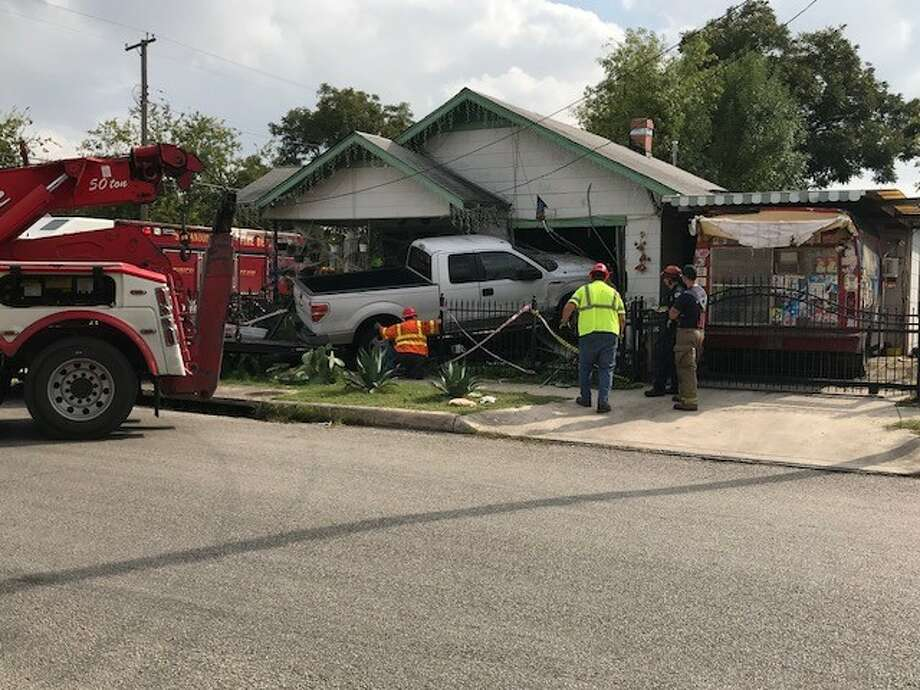 Police say no one was injured when a pickup truck drove into a West Side residence following a collision Saturday, Nov. 4. 2017. Photo: Alexandro M. Luna