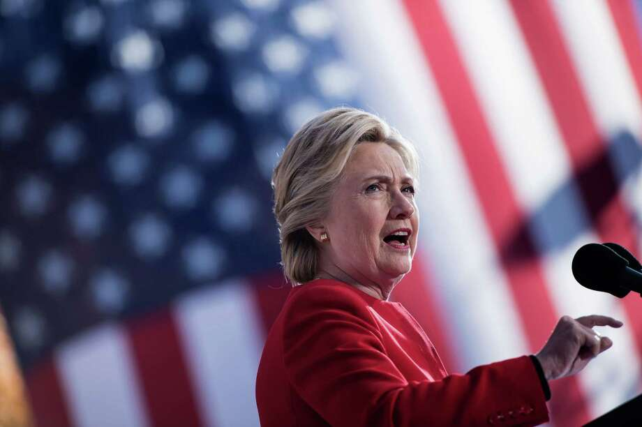 """(FILES) This file photo taken on November 7, 2016 shows Democratic presidential nominee Hillary Clinton speaking during a rally outside the University of Pittsburgh's Cathedral of Learning in Pittsburgh, Pennsylvania. Hillary Clinton got a reminder that exactly one year ago, then FBI director James Comey said he was re-opening a probe into her emails. """"Oh is that today?"""" the former Democratic presidential candidate quipped on Twitter late October 28, 2017, in response to a post by election forecaster Nate Silver who noted the anniversary of Comey's move and said it was """"probably decisive"""" in last year's White House race. / AFP PHOTO / Brendan SmialowskiBRENDAN SMIALOWSKI/AFP/Getty Images Photo: BRENDAN SMIALOWSKI / AFP/Getty Images / AFP or licensors"""