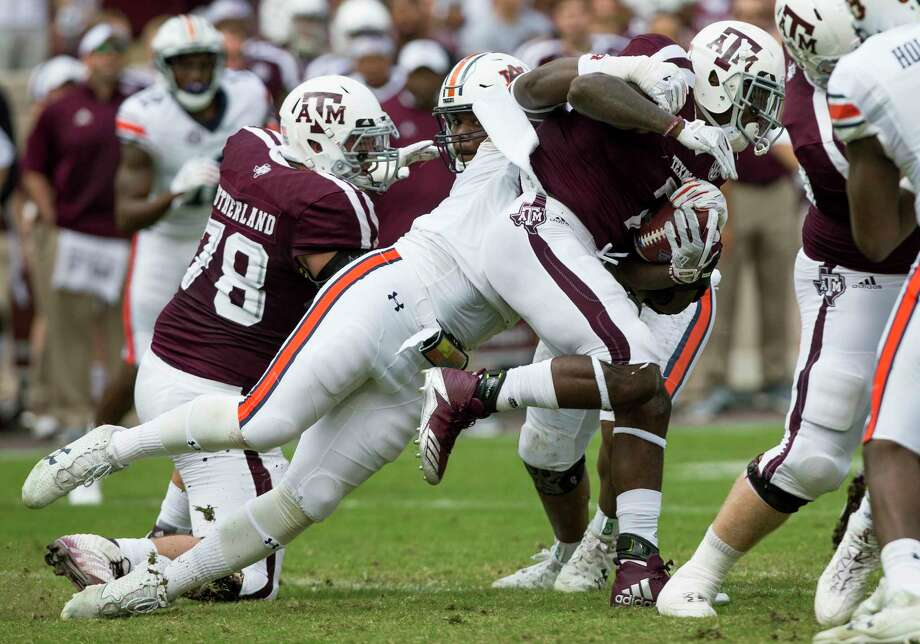 Auburn defensive lineman Marlon Davidson (3) tackles Texas A&M running back Keith Ford (7) after a short gain during the first half of an NCAA college football game on Saturday, Nov. 4, 2017, in College Station, Texas. (AP Photo/Sam Craft) Photo: Sam Craft, FRE / AP