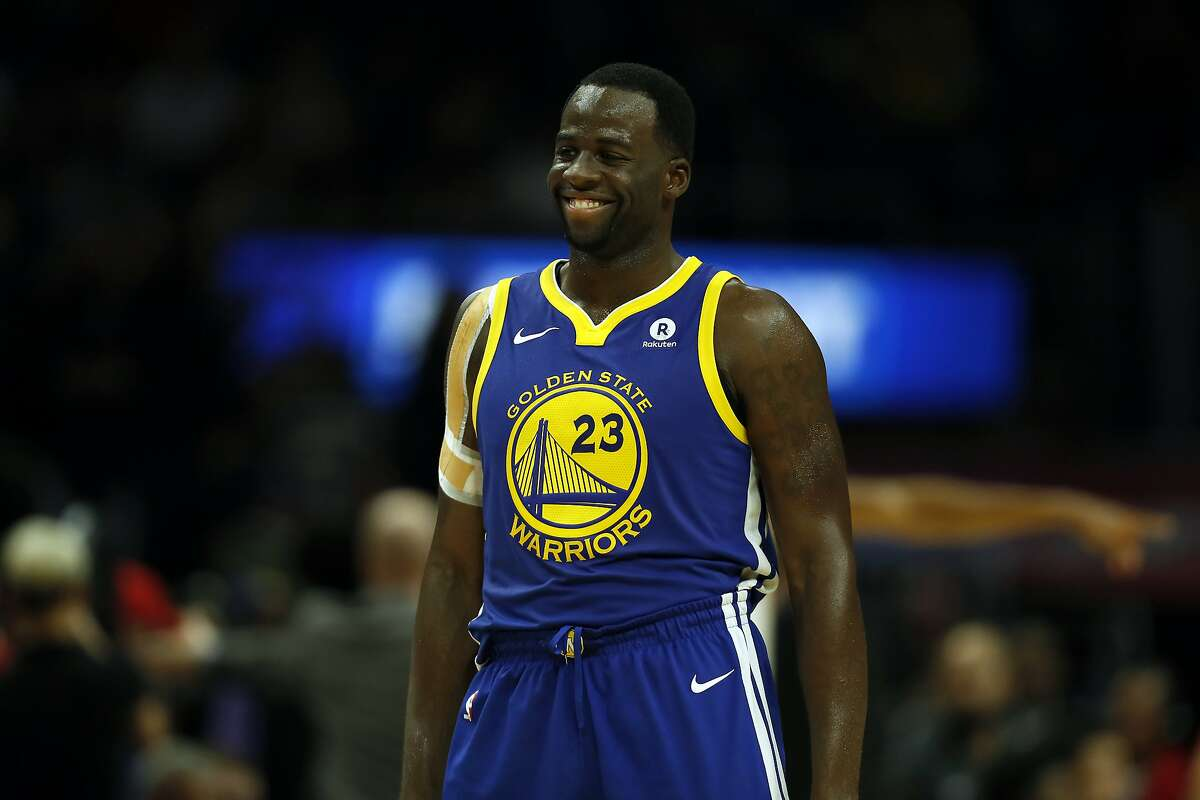 Golden State Warriors forward Draymond Green grins during the second half of an NBA basketball game against the Los Angeles Clippers in this 2017 file photo. Green has good reason to smile these days - he recently signed a $100 million max extension with the Warriors and made a 40x return on an investment in a teeth-straightening company.