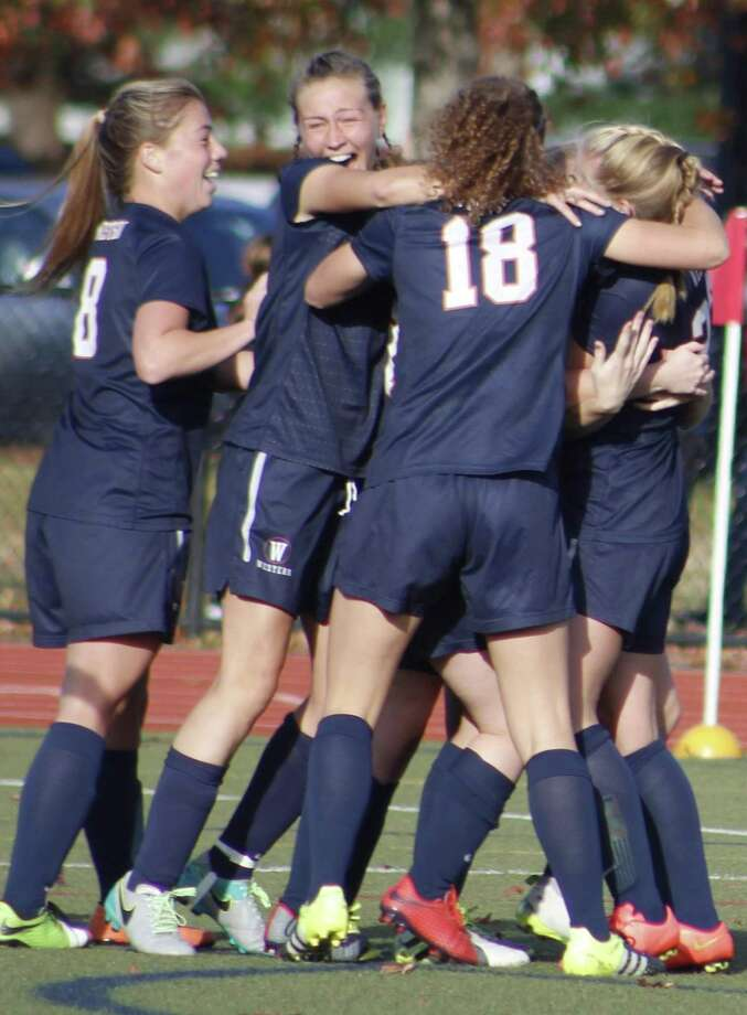 The Western Connecticut State University women's soccer team races out to celebrate with Autumn Sorice after she scored the winning goal in overtime of the Little East Conference championship match against Eastern Connecticut in Mansfield Nov. 4, 2017. Photo: Richard Gregory / Richard Gregory