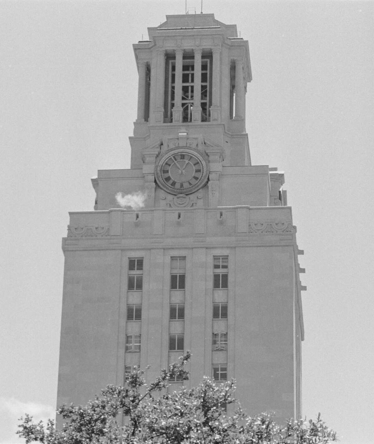A puff of smoke is visible from the University of Texas Tower during a sniping siege on Aug. 1, 1966, by gunman Charles Whitman, who killed 17 people.