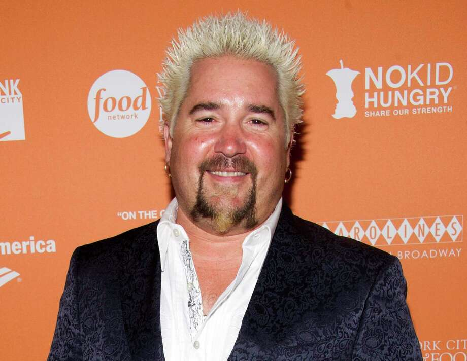 "This Oct. 11, 2012 file photo shows chef Guy Fieri at the  ""On The Chopping Block: A Roast of Anthony Bourdain"" in New York. Fieri is appearing on an episode of ""Jay Leno's Garage"" showing his car collection to the former-""Tonight Show"" host. Photo: Charles Sykes / Invision"