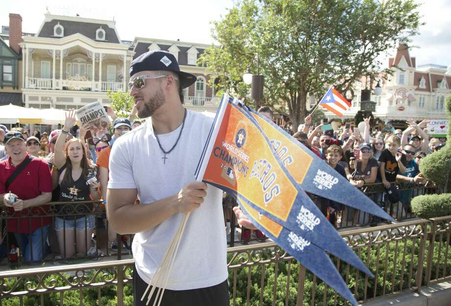Houston Astros player and World Series MVP, George Springer, greets fans at Magic Kingdom Park in Lake Buena Vista, Fla., Saturday, Nov. 4, 2017. Springer later joined All-Star Carlos Correa and American League batting champion Jose Altuve to lead off a Walt Disney World Parade saluting the teamÕs first world title in its 56-year history. (Gregg Newton, photographer) Photo: Gregg Newton