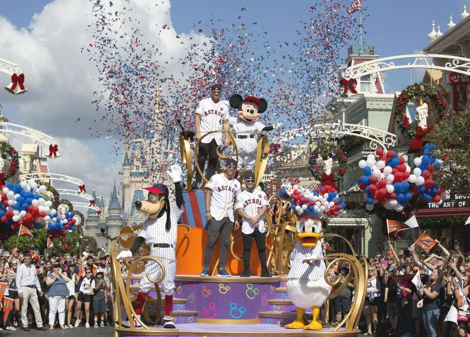 Houston Astros star players (top, then bottom l-r) World Series MVP George Springer, All-Star Carlos Correa and American League batting champion Jose Altuve lead off a World Series victory parade Saturday, Nov. 4, 2017, at Magic Kingdom Park in Lake Buena Vista, Fla. The Walt Disney World Parade saluted the team's first world title in its 56-year history.Browse through the photos for more moments from the Astros' trip to Disney World. Photo: Gregg Newton
