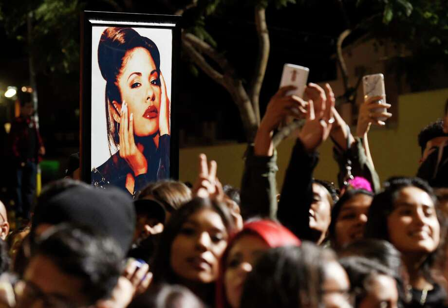 A portrait of the late singer Selena Quintanilla is seen in the crowd following a posthumous star ceremony for Quintanilla on the Hollywood Walk of Fame on Friday, Nov. 3, 2017, in Los Angeles. (Photo by Chris Pizzello/Invision/AP) Photo: Chris Pizzello, INVL / 2017 Invision
