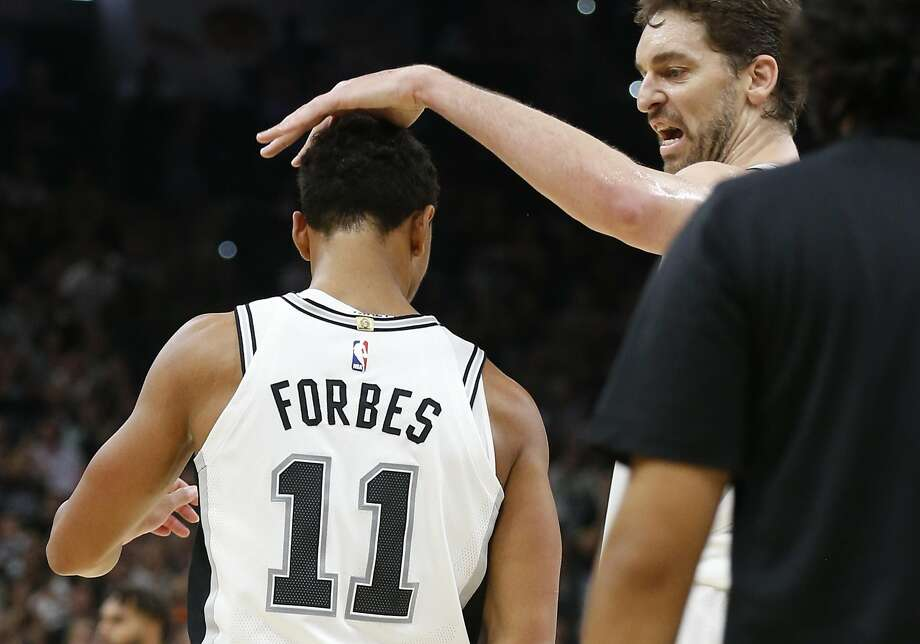 Spurs' Pau Gasol (16) congratulates Bryn Forbes (11) after a score against the Charlotte Hornets in the second half at the AT&T Center on Friday, Nov. 3, 2017. Spurs defeated the Hornets, 108-101. (Kin Man Hui/San Antonio Express-News) Photo: Kin Man Hui, San Antonio Express-News