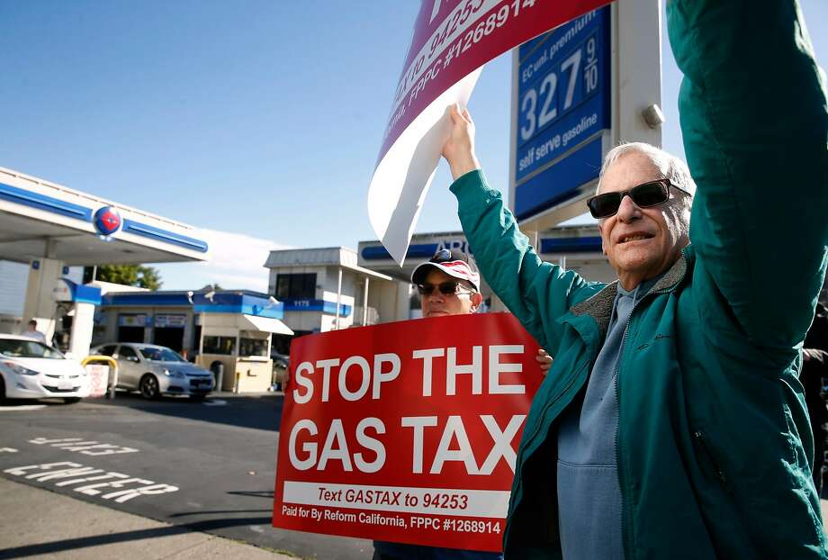 Barry Graynor (left) and Howard Epstein joins a local protest organized by state Republican Party leaders against the statewide 12-cents per gallon gas tax in front of the Arco station at Fell and Divisadero streets in San Francisco, Calif. on Saturday, Nov. 4, 2017. Photo: Paul Chinn, The Chronicle