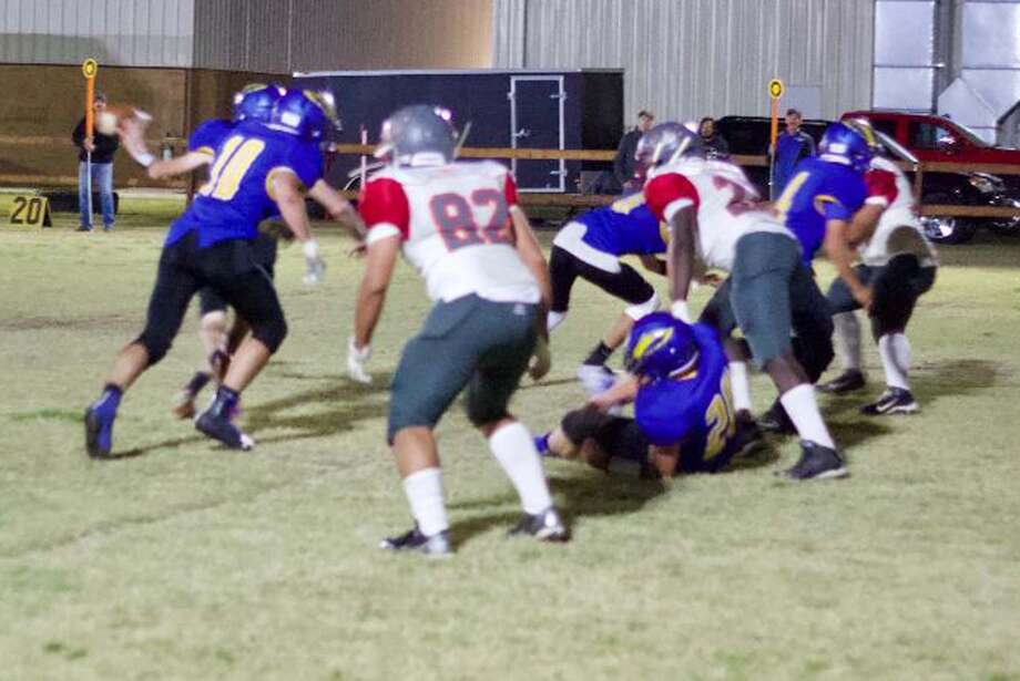 Plainview Christian Academy and Amarillo Holy Cross football players mix it up during a TAPPS six-man game at PCA Friday night. The Eagles defeated Holy Cross, 81-36. Photo: Photo Courtesy Of Don Brown
