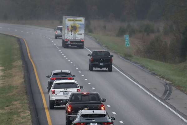 In this photo made Wednesday, Nov. 1, 2017, a driver stays in the passing lane as traffic accumulates behind along I-70 in Montgomery County, Mo. Many states have laws against driving in the left lane except for passing or turning left, which are often ignored by drivers, leading to annoying and dangerous bottlenecks that some experts say are as bad as driving too fast because people get trapped behind and become frustrated prompting some to drive more aggressively. (AP Photo/Jeff Roberson)