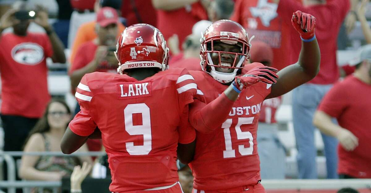 Houston wide receiver Courtney Lark celebrates his touchdown with wide receiver Linell Bonner (15) during the first half of an NCAA college football game against East Carolina, Saturday, Nov. 4, 2017, in Houston. (Michael Wyke/Houston Chronicle via AP)