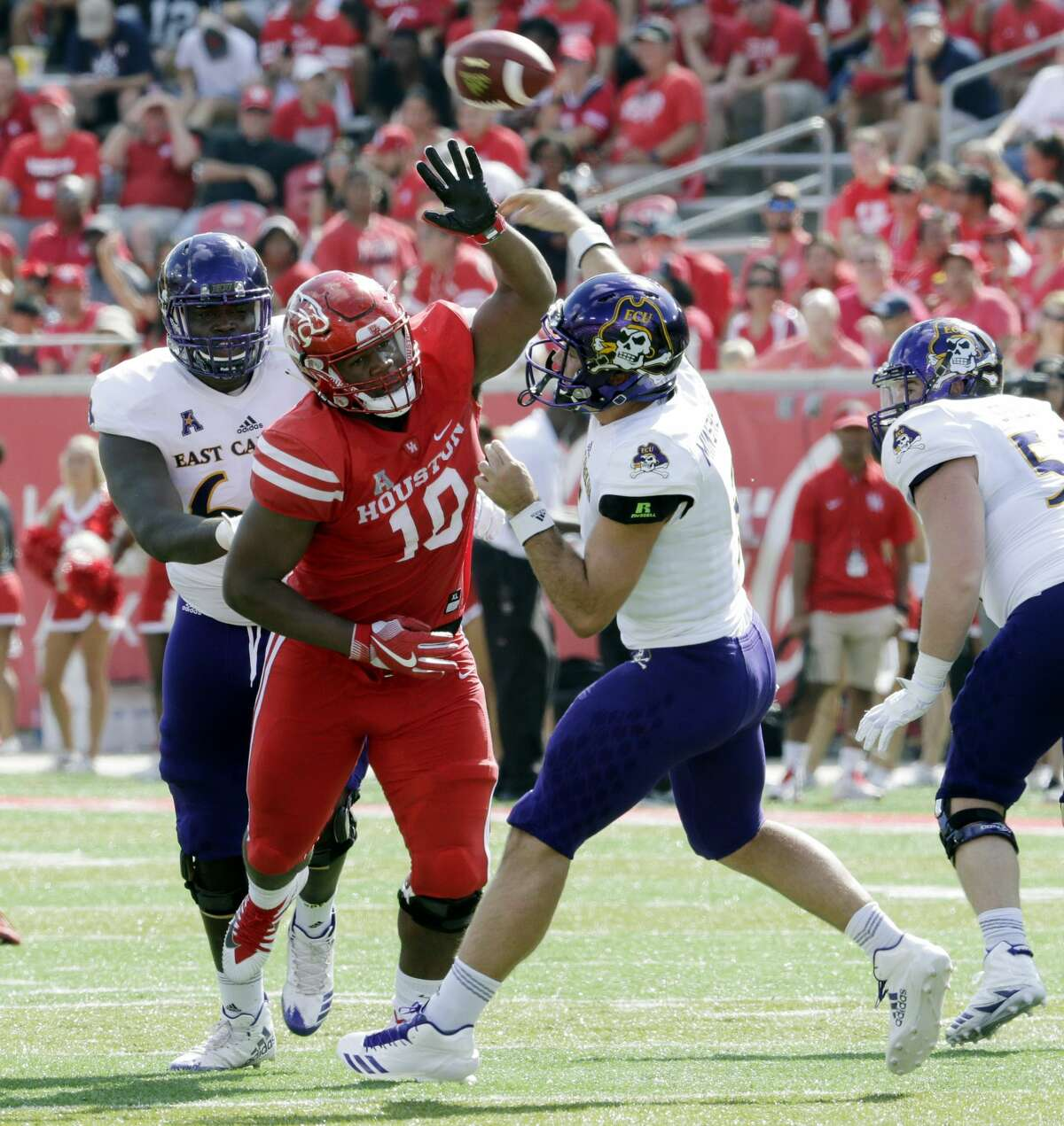 Houston defensive tackle Ed Oliver (10) tries to break up the pass by East Carolina quarterback Gardner Minshew (5) during the first half of an NCAA college football game Saturday, Nov. 4, 2017, in Houston. (Michael Wyke/Houston Chronicle via AP)