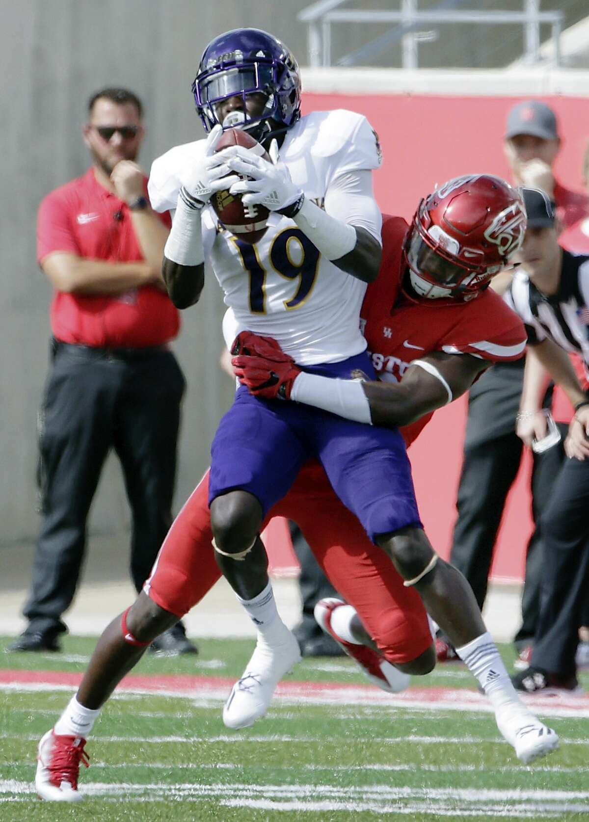 East Carolina wide receiver Mydreon Vines (19) is tackled on his reception by Houston cornerback Ka'Darian Smith (16) during the second half of an NCAA college football game Saturday, Nov. 4, 2017, in Houston. (Michael Wyke/Houston Chronicle via AP)