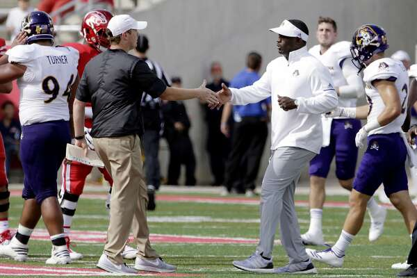 Houston head coach Major Applewhite and East Carolina head coach Scottie Montgomery shake hands at mid field after their NCAA college football game, Saturday, Nov. 4, 2017, in Houston. (Michael Wyke/Houston Chronicle via AP)