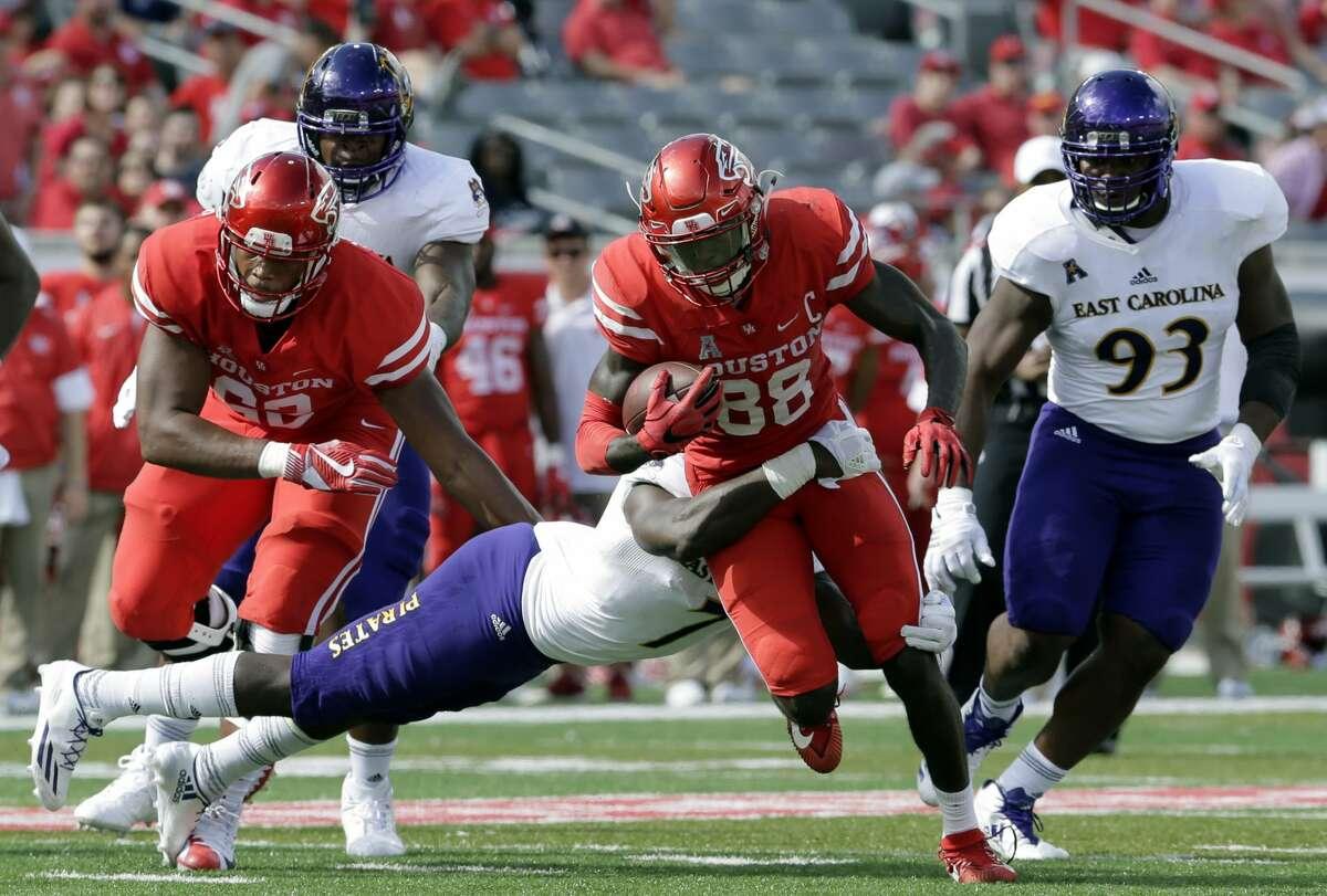 East Carolina linebacker Jordan Williams (7) tackles Houston wide receiver Steven Dunbar (88) during the first half of an NCAA college football game Saturday, Nov. 4, 2017, in Houston. (Michael Wyke/Houston Chronicle via AP)