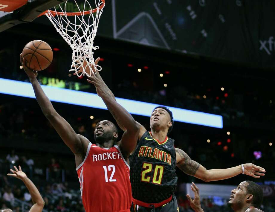 Rockets forward Luc Mbah a Moute, left, appreciates that coach Mike D'Antoni trusts him and allows him to play his game instinctively. Photo: John Bazemore, STF / Copyright 2017 The Associated Press. All rights reserved.