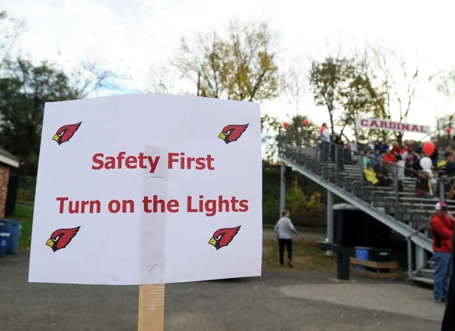 "A sign attached to a fence reads ""Safety First Turn on the Lights,"" during the high school football game between Greenwich High School and Ridgefield High School at Cardinal Stadium in Greenwich, Conn., Saturday, Nov. 4, 2017. Greenwich remained undefeated winning the game 26-21 over Ridgefield. Photo: Bob Luckey Jr., Hearst Connecticut Media / Greenwich Time"