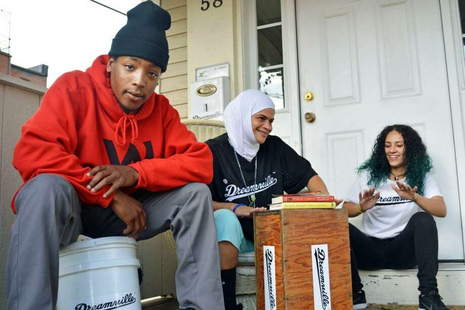 Nur Fitzpatrick, center, has been helping Dwayne, 23, left, and Angie, 16, along with several other homeless young people in Middletown, by collecting clothing, food and personal care items, reaching out to local organizations and connecting them to resources. Photo: Cassandra Day / Hearst Connecticut Media