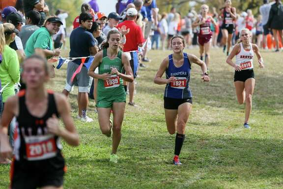 Bandera's Ashlyn Persyn (1921) heads towrds the finish line of the 4A Girls 3200 meter run during the UIL high school cross country state meet at Old Settlers Park in Round Rock on Saturday, Nov. 4, 2017.  Persyn finished 17th to hel the Bulldogs capture the 4A Girls team championship for the fourth year in row.  MARVIN PFEIFFER/mpfeiffer@express-news.net