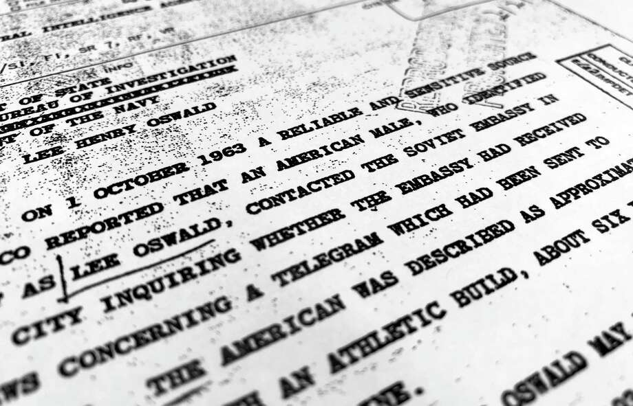"Part of a file from the CIA, dated Oct. 10, 1963, details ""a reliable and sensitive source in Mexico"" report of Lee Harvey Oswald's contact with the Soviet Union embassy in Mexico City, that was released for the first time on Friday, Nov. 3, 2017, by the National Archives. Documents show U.S. officials scrambling after the assassination of President John F. Kennedy to round up information about Lee Harvey Oswald's trip to Mexico City weeks earlier. (AP Photo/Jon Elswick) Photo: Jon Elswick, STF / AP"