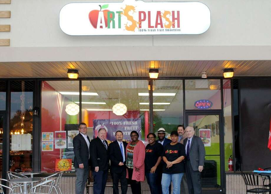 Art Splash held a grand opening at 544 Main St., Cromwell. From left are: chairman, Cromwell Division, Middlesex County Chamber of Commerce, Rodney Bitgood; Vice Chairman Jay Polke, Chairman Rick Morin, Joyce Addo, founder of Art Splash; Samantha Jenkins, Edmund Amate, Pamela Jenkins, Cromwell Mayor Enzo Faienza and Chamber President Larry McHugh. Photo: Contributed Photo