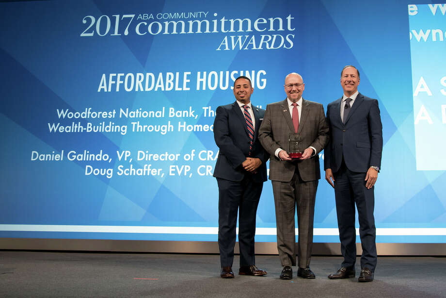 From left: Doug Schaeffer, executive vice president-CRA director for Woodforest National Bank; Daniel Galindo, vice president and director, CRA Strategic Initiatives, Woodforest National Bank; and Robert (Rob) S. Nichols, president and CEO of the American Bankers Association, Photo: Submitted / Photography by Bruno Passigatti | www.bauwerks.com