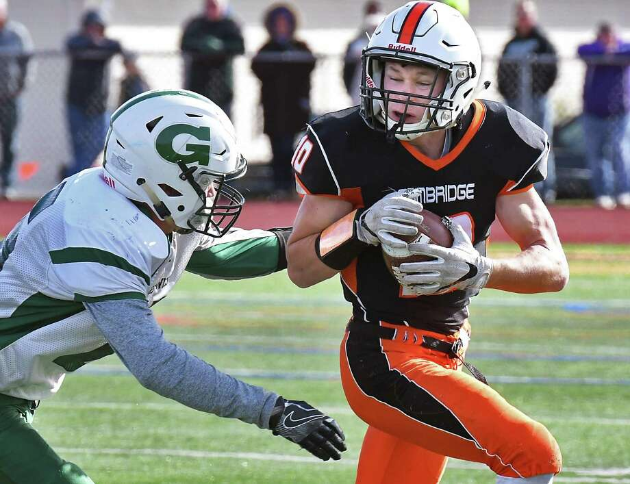 Cambridge's #10 Jonas Butz runs out of the reach of a Greenwich defender during their Class D Super Bowl Saturday Nov. 4, 2017 in Schuylerville, NY.  (John Carl D'Annibale / Times Union) Photo: John Carl D'Annibale / 20042007A
