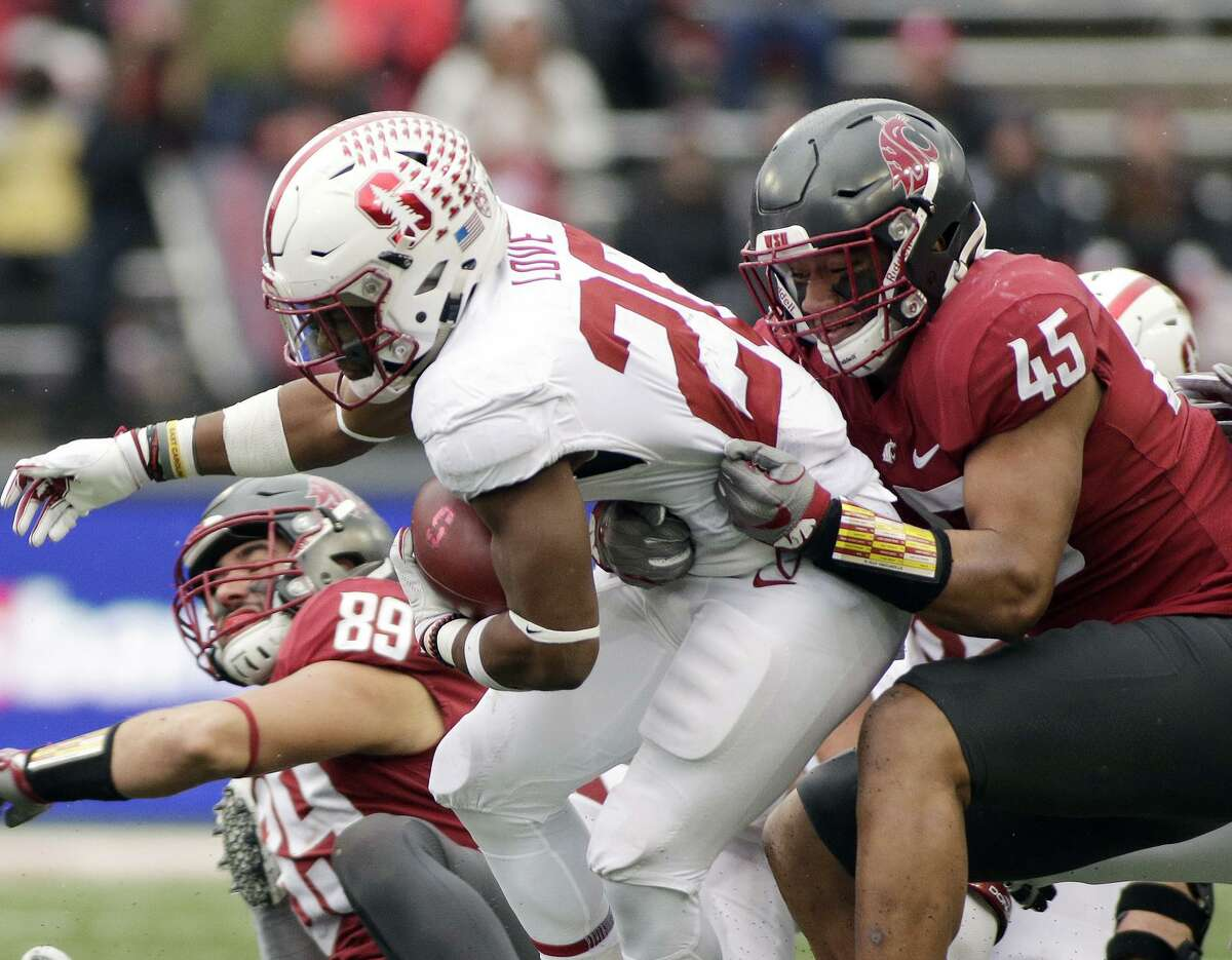 Washington State linebacker Logan Tago tackles Stanford running back Bryce Love in a critical loss for the Cardinal.