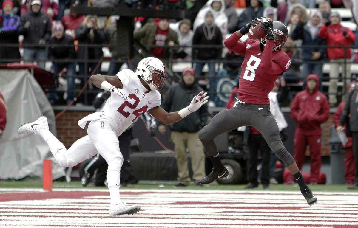 Washington State wide receiver Tavares Martin Jr. scores on a 12-yard pass as Stanford cornerback Quenton Meeks trails behind. The Cardinal lost 24-21.