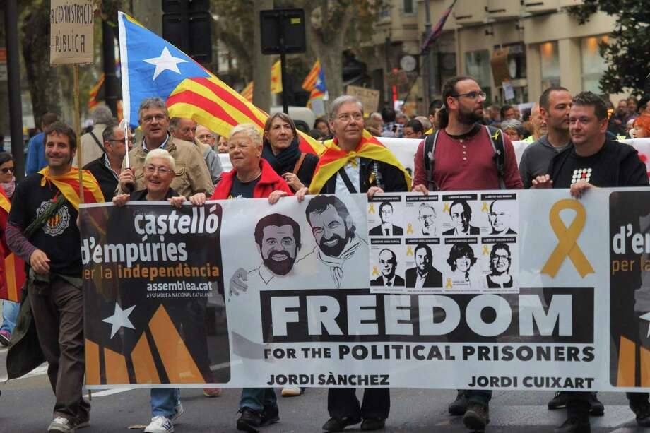 People carry a banner during a demonstration commemorating Catalonia independence from Spain on Saturday, in Perpignon. Photo: RAYMOND ROIG, Contributor / AFP or licensors