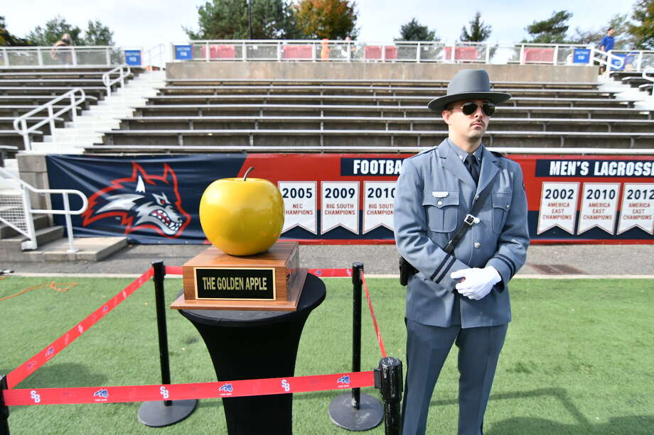 A guard watches over the Golden Apple trophy that UAlbany and Stony Brook played for in their football game on Saturday, Nov. 4, 2017. Stony Brook won 28-21 at LaValle Stadium. (Jim Harrison / Stony Brook Athletics)