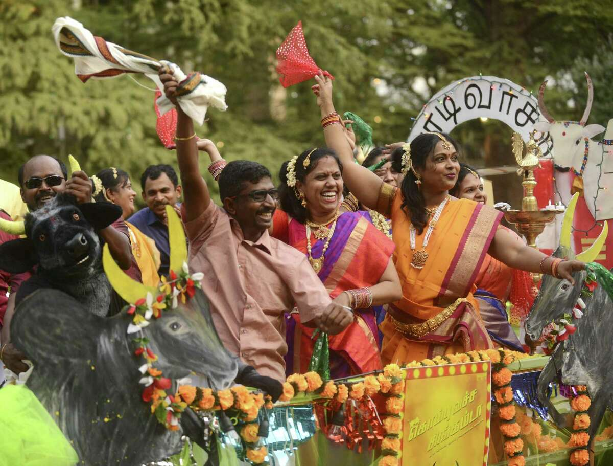 Participants display enthusiasm as they ride the barge representing the Indian state of Tamil Nadu during the Diwali San Antonio Festival of Lights at La Villita and the Arneson River Theatre. Diwali is India's most important holiday.