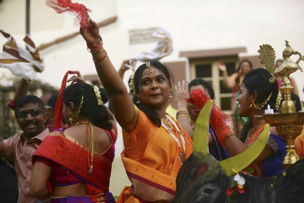 People display enthusiasm as they ride the barge representing the Indian state of Tamil Nadu during the Diwali San Antonio Festival of Lights at La Villita and the Arneson River Theatre on Saturday, Nov. 4, 2017. Diwali is India's most important holiday, and celebrates victory of good over evil.