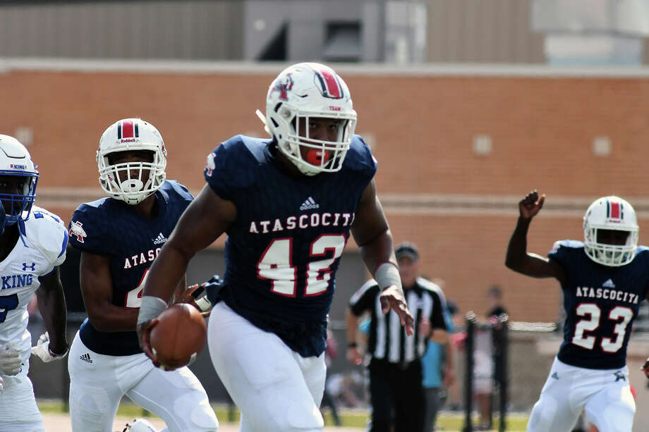 Atascocita junior defensive lineman Bryton Thompson (42) carries the ball into the end zone for a touchdown in the first quarter after Eagles senior linebacker Jaylon Allen stripped the ball from C. E. King senior quarterback Tarron Donaldson (2) n the first quarter of their District 21-6A matchup at Turner Stadium in Humble on Nov. 4, 2017. (Photo by Jerry Baker/Freelance) Photo: Jerry Baker, Freelance / Freelance